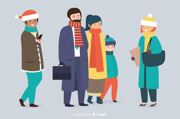 冬の服を着ている人々のグループ