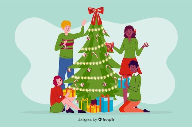 ツリーを飾るクリスマスの人々