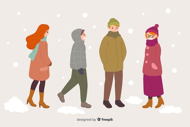 冬の服を着て歩く人々のグループ