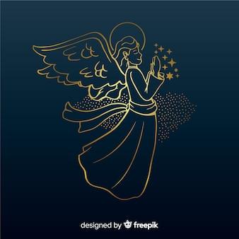青色の背景と黄金のクリスマスの天使の側面図
