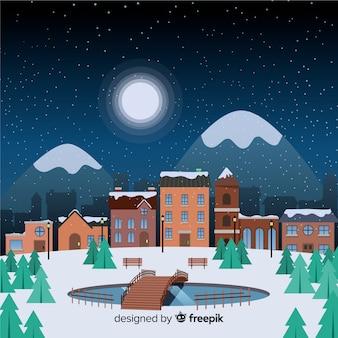 Плоский рождественский городок в звездную ночь с горами