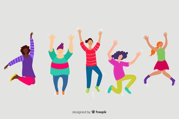 Молодые люди прыгают в воздухе
