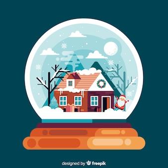 家のフラットクリスマス背景を持つグローブ