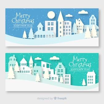 Набор рождественских баннеров города в бумажном стиле