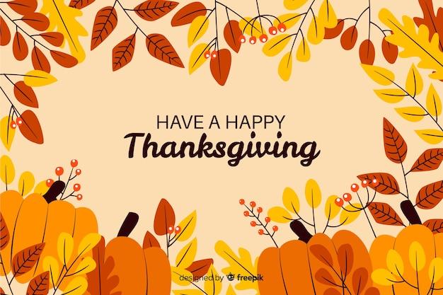 幸せな感謝祭の乾燥葉とカボチャを
