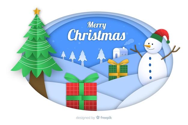 クリスマスツリーと雪だるまの紙のスタイルでクリスマスの背景