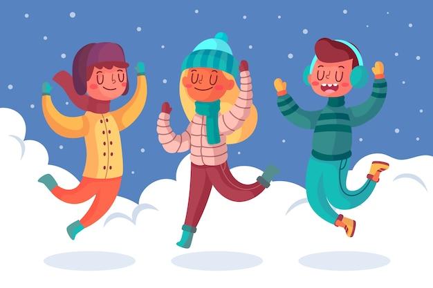 Молодые люди прыгают в снегу