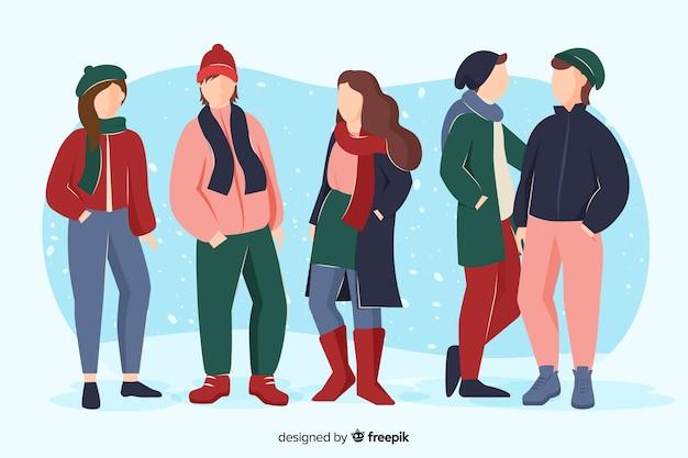 一緒に時間を過ごし、冬の服を着ている友人