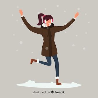 Молодая женщина в зимней одежде и прыжки