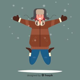 Молодой человек в зимней одежде и прыжки