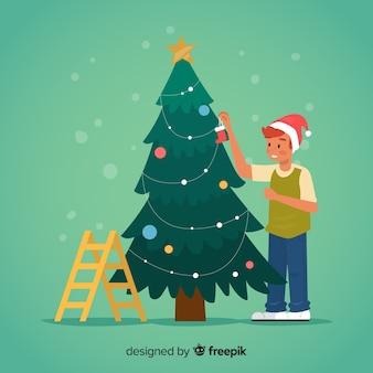 Мальчик украшает елку