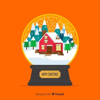 Плоский рождественский снежный шар с домиком