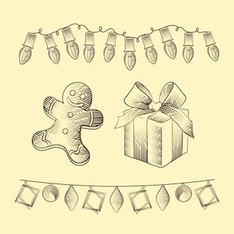 ジンジャーブレッド人のクッキーとビンテージのクリスマスの装飾