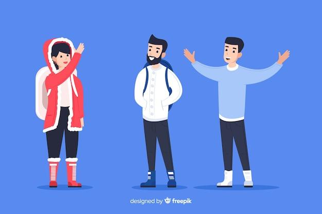 冬の服を着て、お互いに手を振っている人