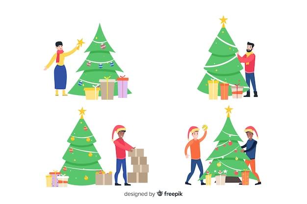 クリスマスツリーを飾るかわいい漫画の人々の大きなセット
