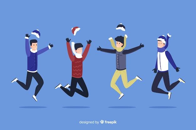 冬シーズンの背景をジャンプする帽子を持つ人々