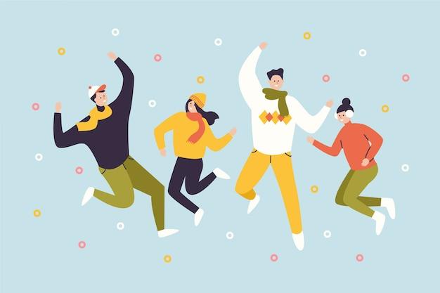 Прыжки молодых счастливых людей в повседневной зимней одежде
