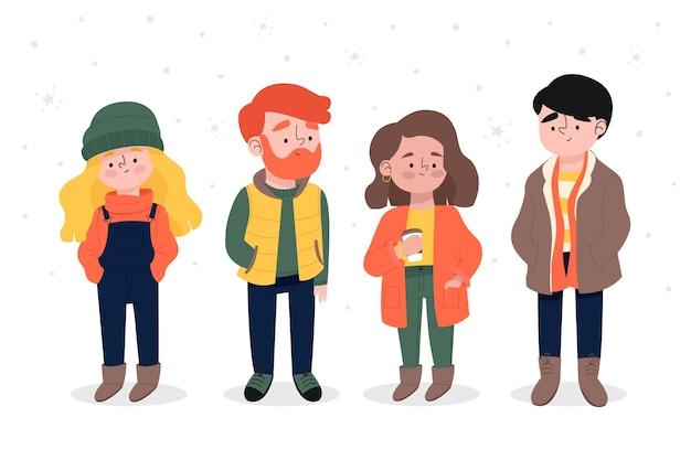 Молодые люди в зимней одежде и стоящие на снегу