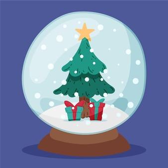 Ручной обращается рождественский снежный шар с елкой