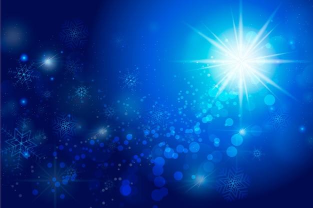 クリスマスの輝く粒子の背景