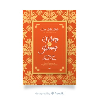 オレンジ色のエレガントなダマスク織の結婚式の招待状のテンプレート