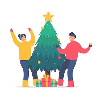若者がクリスマスツリーを飾る