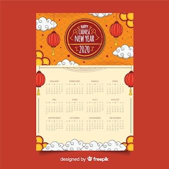 Ручной обращается китайский календарь на новый год