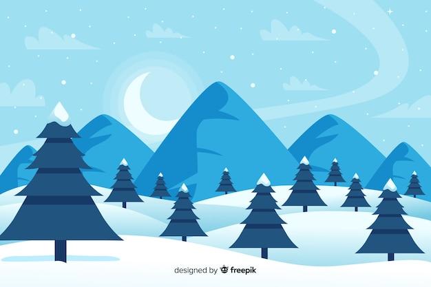 冬のクリスマスツリーと山の森