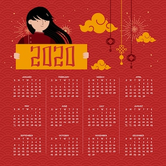 長い黒髪の少女と赤い旧正月カレンダー