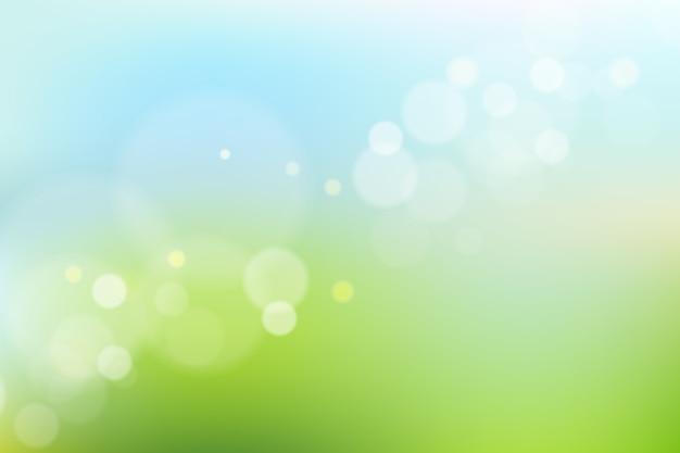 Синий и зеленый градиентный фон с эффектом боке