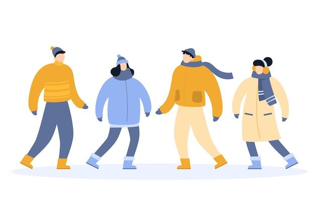 冬の服を着て平らな人々