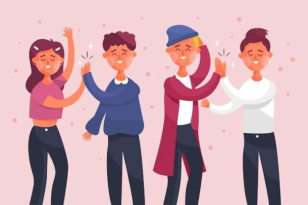 Молодые люди дают высокие пять