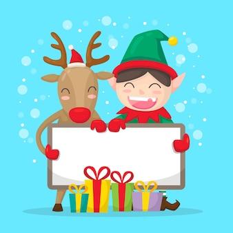 クリスマスのエルフとトナカイの空白のバナーを保持