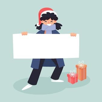 白紙の横断幕を持って幸せなクリスマスキャラクター