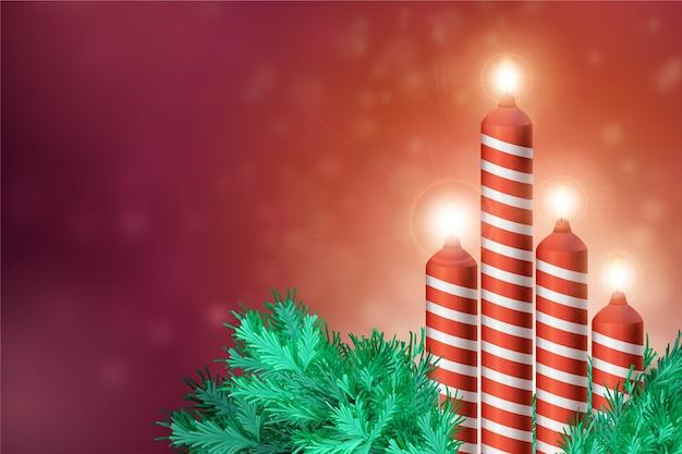 背景の現実的なクリスマスキャンドル