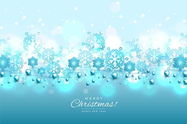 キラキラ効果で青い雪片の背景