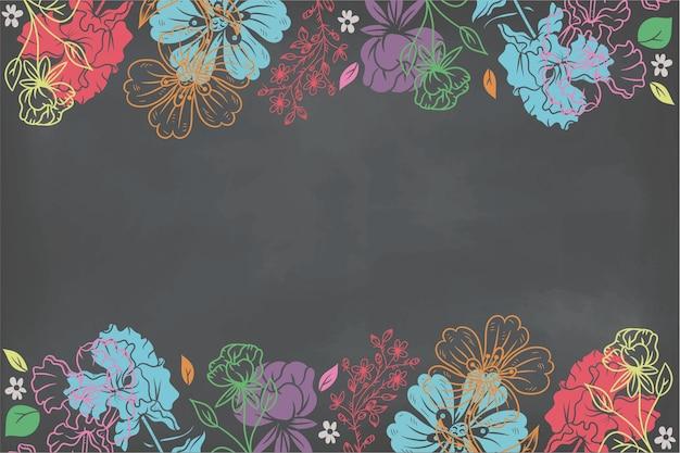 Рисованные цветы на фоне доски