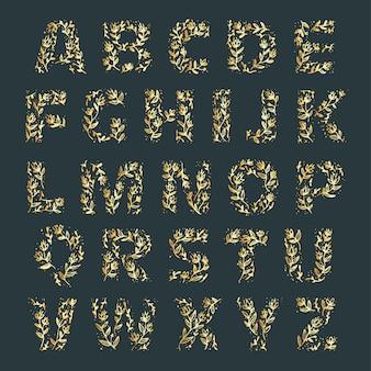 文字にエレガントな花を持つ黄金のアルファベット