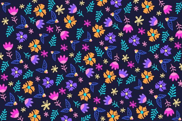 暗い青色の背景にカラフルな頭が変な花柄