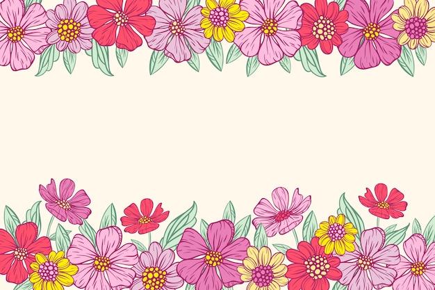 ホワイトボードの背景に描かれたカラフルな花