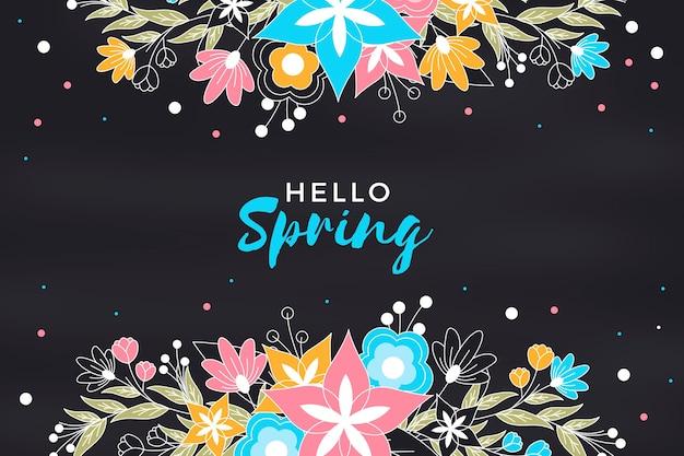 こんにちは春黒板背景の花を持つ