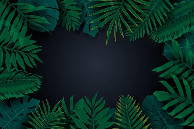 現実的な暗い熱帯の葉のフレームの背景
