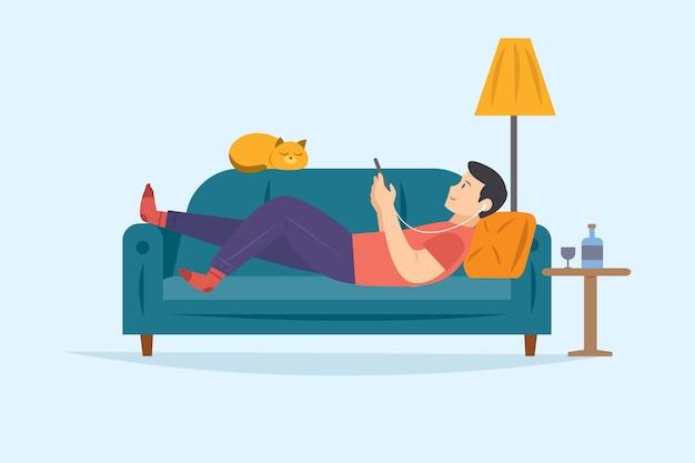 スマートフォンで音楽を聴きながらリラックスできるソファの上の男