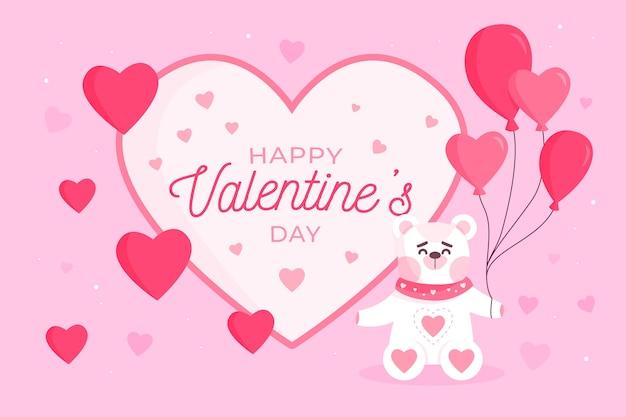 風船を保持しているクマとバレンタインデーの背景