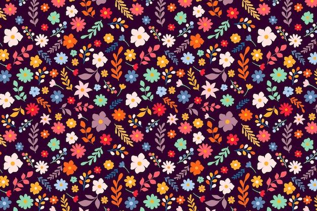 かわいいカラフルな頭が変な花柄の背景