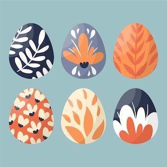 手描きの自然と幸せなイースターの日の卵塗装デザイン