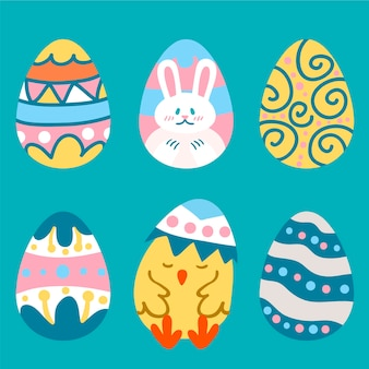 Ручной обращается пасхальные яйца с кроликом и курицей