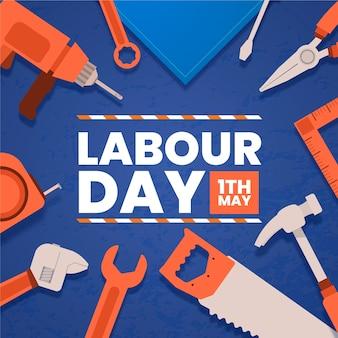 フラットなデザインの労働者の日オレンジ色のツール