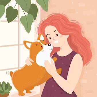 Женщина и милая собака корги