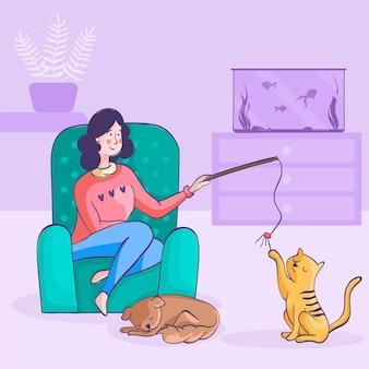 彼女の猫と遊ぶ女性